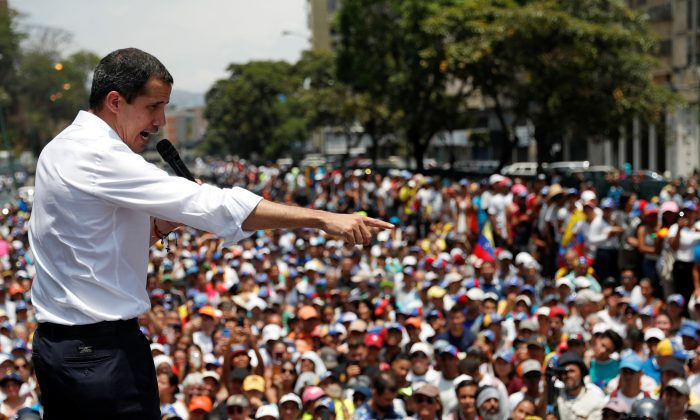 Venezuelan opposition leader Juan Guaido, who many nations have recognised as the country's rightful interim ruler, gestures as he speaks to supporters during a rally against the government of Venezuela's Nicolas Maduro and to commemorate May Day in Caracas Venezuela, May 1, 2019. (Carlos Garcia Rawlins/Reuters)