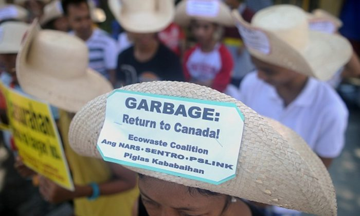 Environmental activists rally outside the Philippine Senate in Manila to demand that scores of containers filled with household rubbish be shipped back to Canada and to push for the ratification of the Basel Ban Amendment which prohibits the export of hazardous waste from developed to developing countries ,on Sept. 9, 2015. (Jay Directo/AFP/Getty Images)