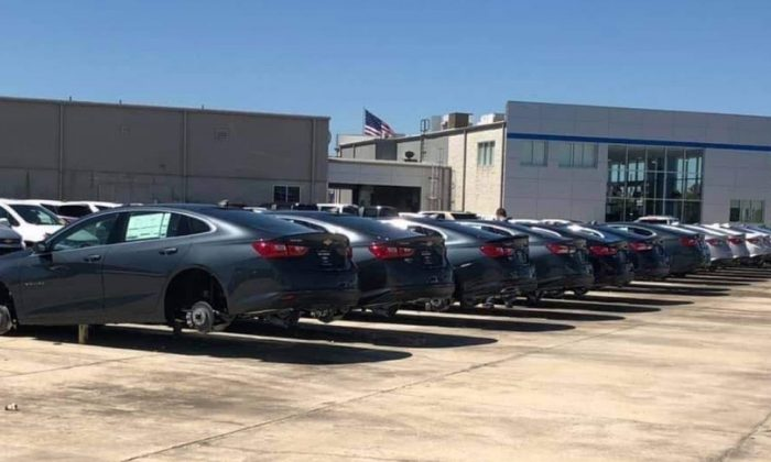 A Louisiana Chevrolet dealership is offering $25,000 to anyone who can help police find thieves who stole tires and wheels from 31 vehicles in its lot. (Facebook / Slidell Police)