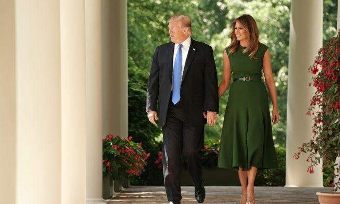 President Donald Trump (L) and First Lady Melania Trump walk out of the Oval Office during a National Day of Prayer service in the Rose Garden at the White House on May 2, 2019. (Chip Somodevilla/Getty Images)