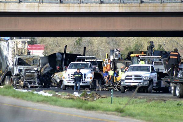 Authorities survey the scene of a fiery crash on I-70