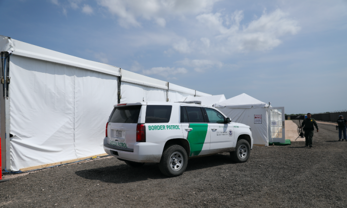A Border Patrol truck sits outside a new Border Patrol tent facility for processing and holding illegal immigrants in Donna, Texas, on May 2, 2019. (Charlotte Cuthbertson/The Epoch Times)