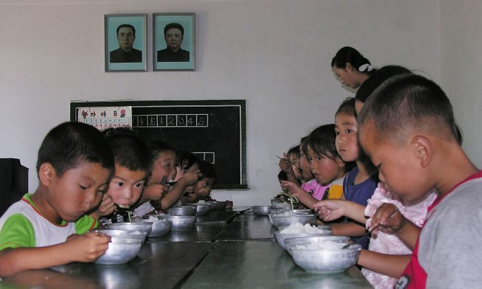 North Korean children eat lunch at a government run kindergarten at Taedong county in North Korea on July 18, 2005. (Gerald Bourke/World Food Program via Getty Images)