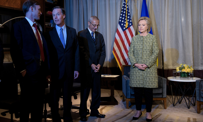 Clinton advisors Jake Sullivan (L), Nick Burns (2L) and John Podesta (2R) wait with Clinton Campaign Chairman, Democratic presidential nominee Hillary Clinton for a meeting with Ukrainian President Petro Poroshenko on Sept. 19, 2016 in New York. (Brendan Smialowski/AFP/Getty Images)