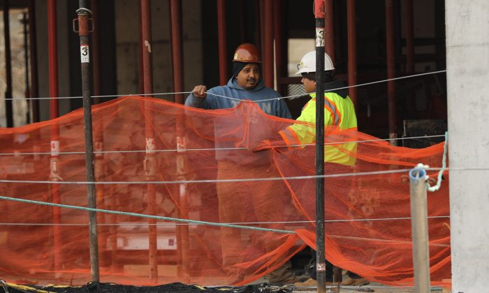 Construction workers are seen at a building site in New York City on March 8, 2019. (Spencer Platt/Getty Images)
