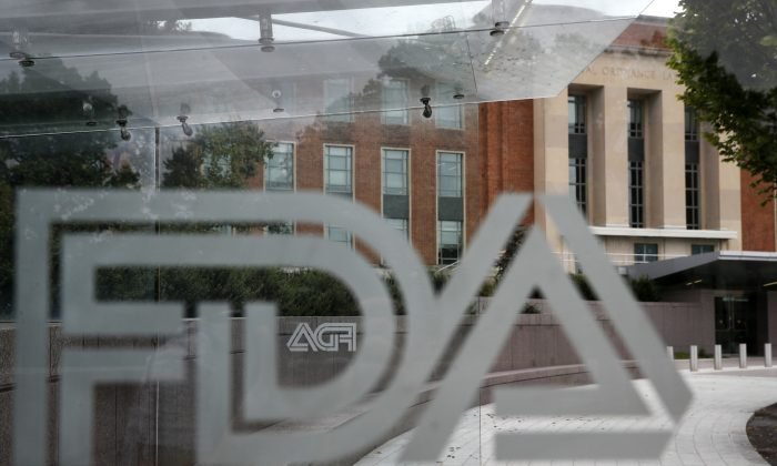 The U.S. Food and Drug Administration building behind FDA logos at a bus stop on the agency's campus in Silver Spring, Md. on Aug. 2, 2018. (Jacquelyn Martin/AP)