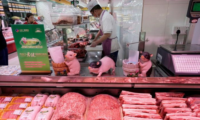 Pork on sales shelf at a supermarket in Beijing on April 11, 2019. (Reuters)