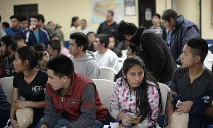 A group of 228 immigrants deported from the United States wait their turn to be registered by migration authorities upon their arrival at the Air Force base in Guatemala City on Jan.10, 2018.  (Johan Ordonez/AFP/Getty Images)