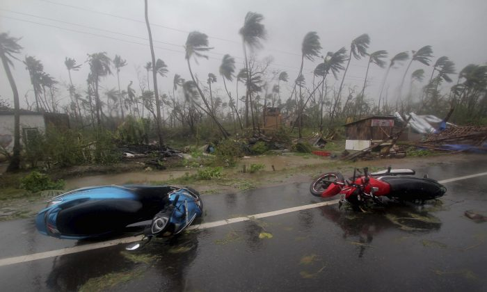 Motorcycles lie on a street in Puri district after Cyclone Fani hit the coastal eastern state of Odisha, India, on May 3, 2019. (AP Photo)