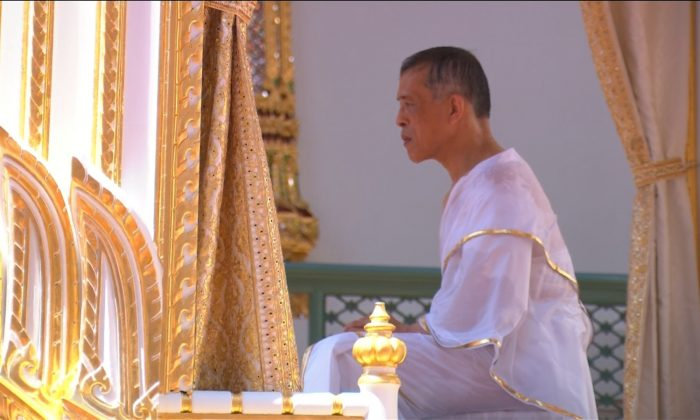 Thailand's King Maha Vajiralongkorn, donning white robes, undergoes a purification ritual during a ceremony before being officially crowned in Bangkok, Thailand, May 4, 2019. (Reuters still image/Reuters TV)