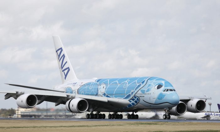 "Japan's All Nippon Airways (ANA) Airbus A380 aircraft, called the ""Flying HONU"", taxies upon its arrival at Narita International airport on March 21, 2019. (JIJI Press/AFP/Getty Images)"