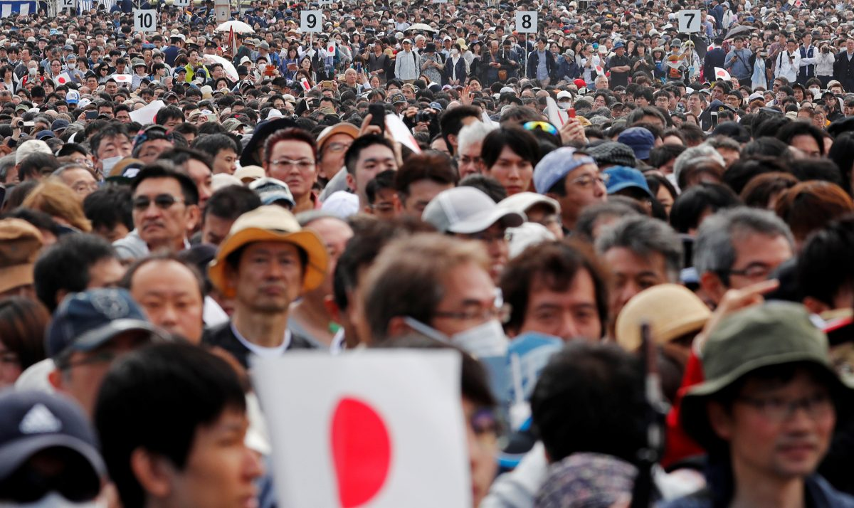 People wait in line to enter the Imperial Palace