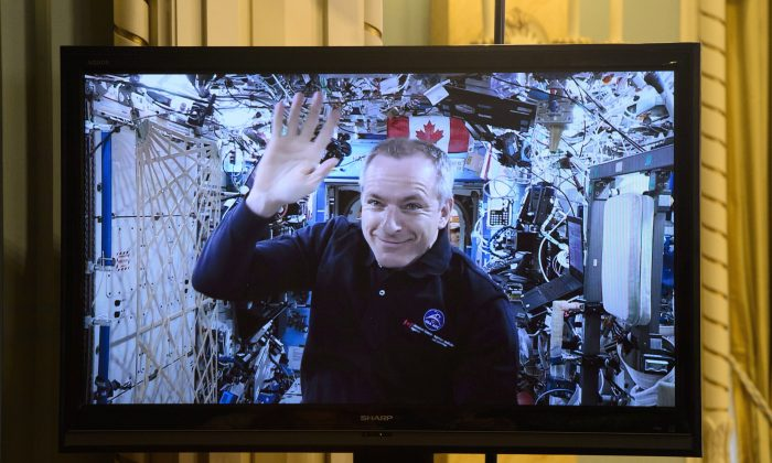 Canadian Space Agency astronaut David Saint-Jacques is seen on a live monitor from the International Space Station during a video conference with Prime Minister Justin Trudeau and Governor General Julie Payette and a group of students at Rideau Hall in Ottawa on Jan. 14, 2019. (The Canadian Press/Sean Kilpatrick)