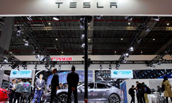 People visit a Tesla booth during the media day for the Shanghai auto show in Shanghai, China April 16, 2019. (Aly Song/Reuters)