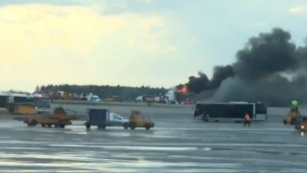 Smoke billows from a Sukhoi passenger plane after it made an emergency landing due to an onboard fire at Sheremetyevo International Airport