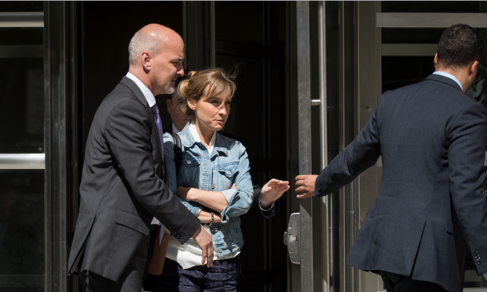 Actress Allison Mack exits the U.S. District Court for the Eastern District of New York following a status conference, June 12, 2018 in the Brooklyn borough of New York City. (Drew Angerer/Getty Images)