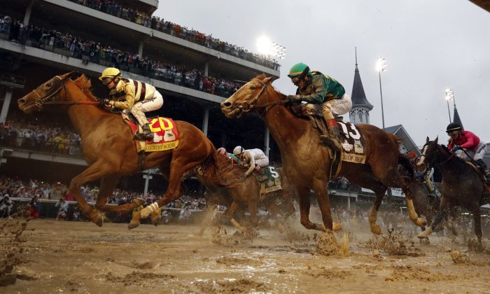 Flavien Prat rides Country House (L) to the finish line during the 145th running of the Kentucky Derby horse race at Churchill Downs in Louisville, Ky., on May 4, 2019. (Matt Slocum/AP Photo)