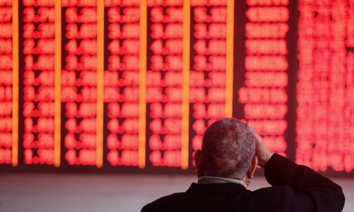 An investor monitors stock prices at a securities company in Hangzhou, Zhejiang province on Dec. 3, 2018. (STR/AFP/Getty Images)