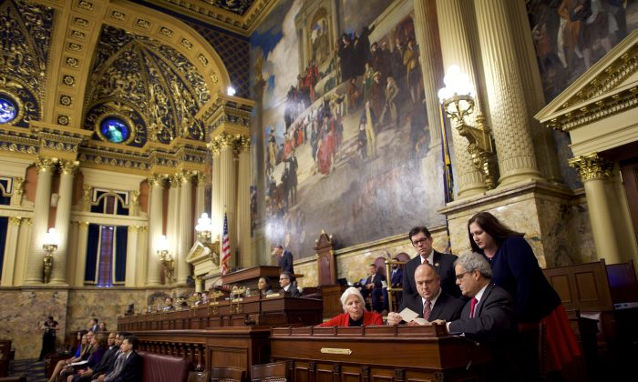 (R) Charlie Gerow and fellow tellers count the elector's votes from a ballot box in the House of Representatives chamber of the Pennsylvania Capitol Building December 19, 2016 in Harrisburg, Pennsylvania. Mark Makela/Getty Images