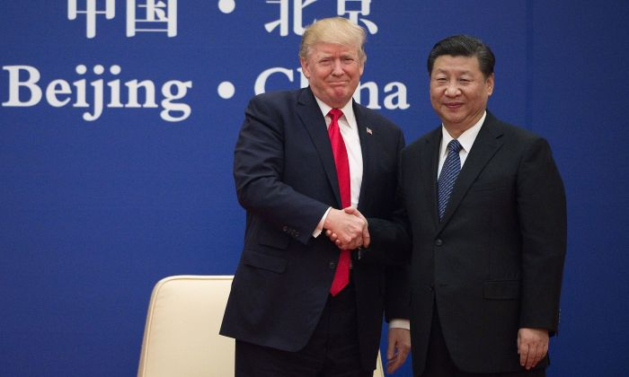 U.S. President Donald Trump and Chinese leader Xi Jinping shake hands during a business leaders event at the Great Hall of the People in Beijing on November 9, 2017. (Nicolas Asfouri/AFP/Getty Images)