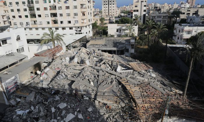 A picture shows the remains of a building in Gaza City on May 5, 2019, after it was hit during retaliatory Israeli air strikes on the Palestinian enclave. Hamas and Islamic Jihad terrorists fired fresh rocket barrages at Israel early Sunday, killing one and wounding dozens. (Mahmud Hams/AFP/Getty Images)