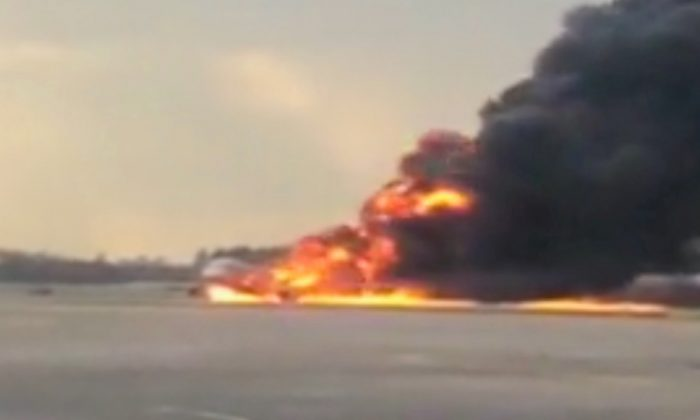 A Sukhoi passenger plane is engulfed in flames after it made an emergency landing due to an onboard fire at Sheremetyevo International Airport, outside Moscow, Russia on May 5, 2019. (Mikhail Norenko via Reuters)