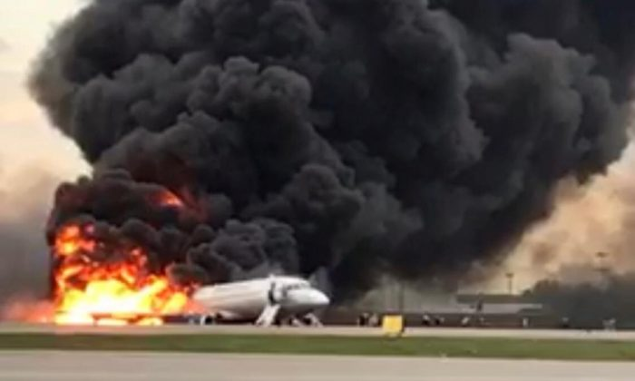 A passenger plane is seen on fire after an emergency landing at the Sheremetyevo Airport outside Moscow on May 5, 2019. (The Investigative Committee of Russia/Handout via Reuters)