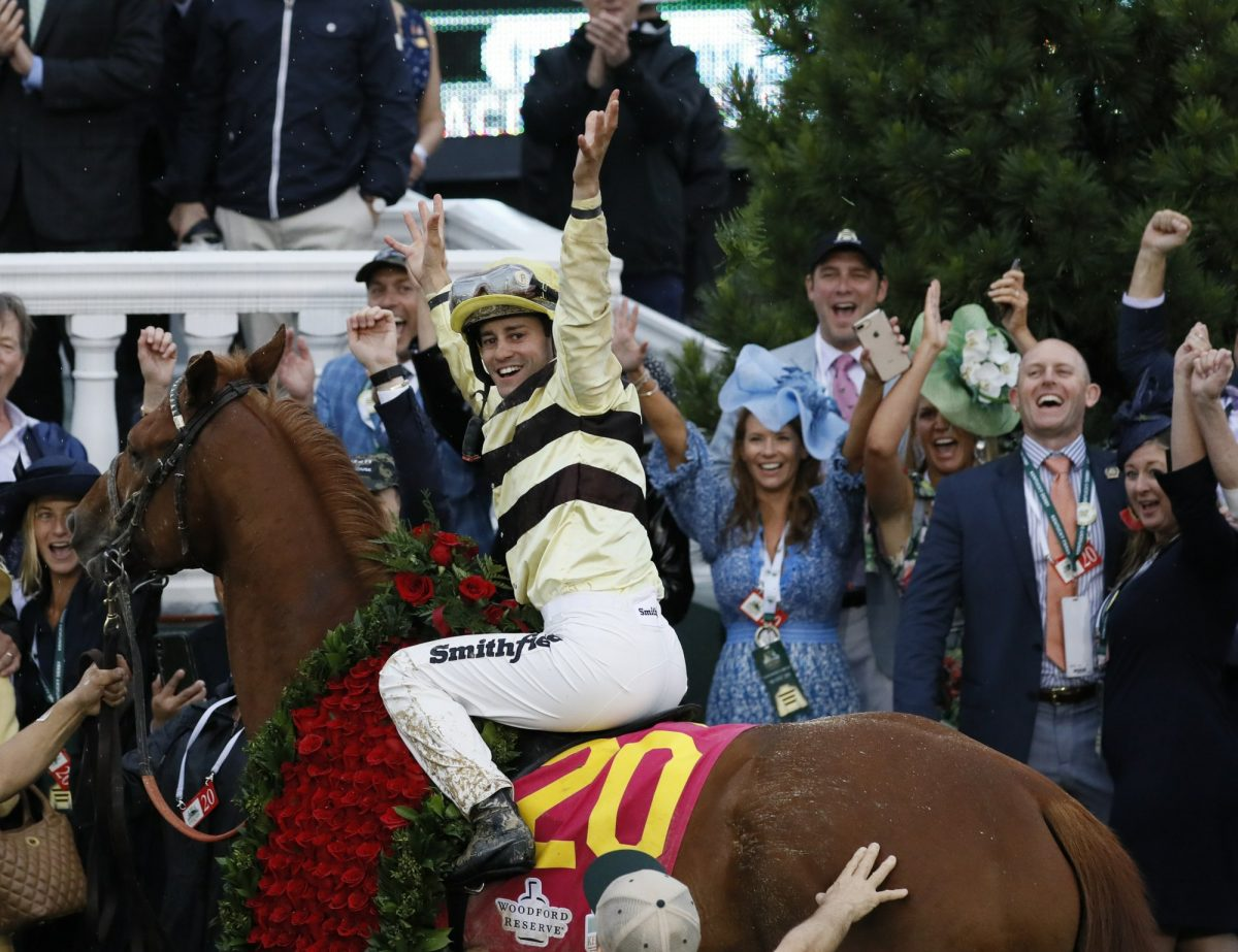 Flavien Prat celebrates after riding Country House to first place