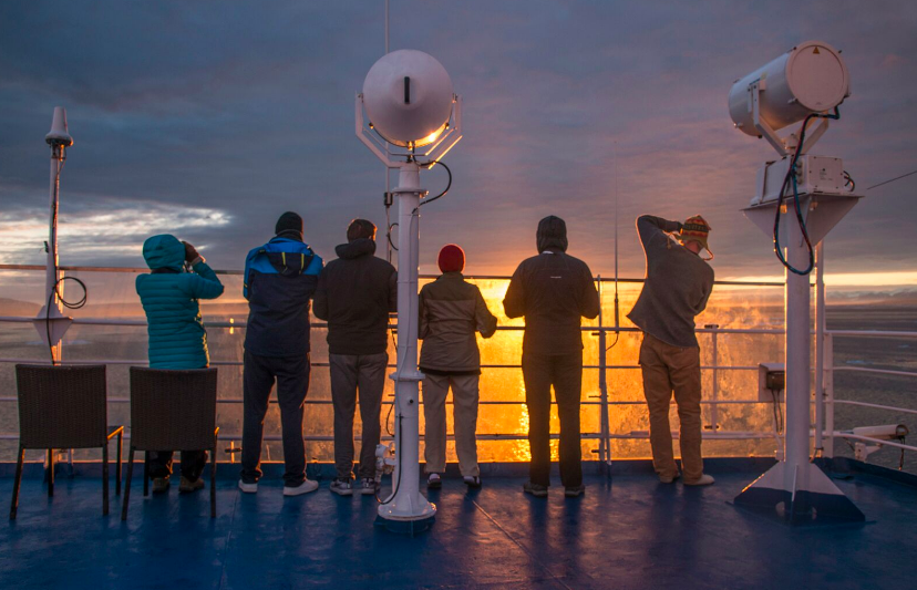 passengers looking at sun