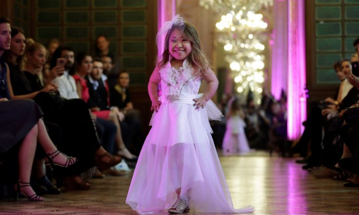A model presents a creation during the International Dwarf Fashion Show. (Thomas Samson/AFP/Getty Images)
