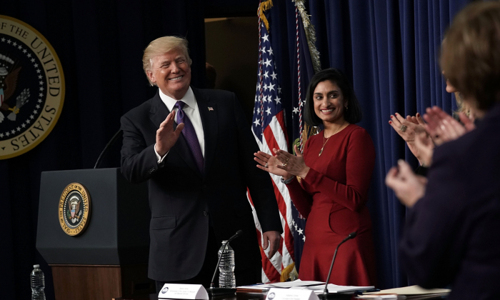 President Donald Trump (L) acknowledges the audience as Administrator of the Centers for Medicare and Medicaid Services Seema Verma (2nd L) looks on in the Eisenhower Executive Office Building in Washington on Jan. 18, 2018. (Alex Wong/Getty Images)