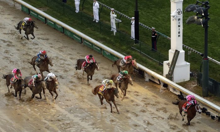 Luis Saez rides Maximum Security to the finish line first against Flavien Prat on Country House during the 145th running of the Kentucky Derby horse race at Churchill Downs on May 4, 2019. (Charlie Riedel/AP Photo)