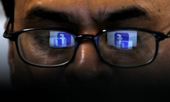 Facebook logo is reflected in glasses on April 1, 2019. (Reuters/Akhtar Soomro/Illustration/File Photo)