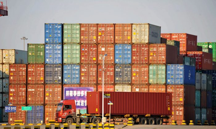 A truck transports a shipping container at Qingdao port in Shandong Province, China on Oct. 12, 2018. (China Daily/via Reuters)