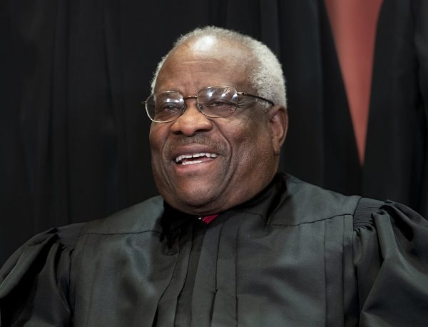 Supreme Court Associate Justice Clarence Thomas,