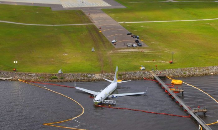Aerial view of the Miami Air International Boeing 737-800 that overran the runway at NAS Jacksonville and came to rest in the St Johns River in Jacksonville, Fla., on May 4, 2019. (NTSB/Handout via Reuters)