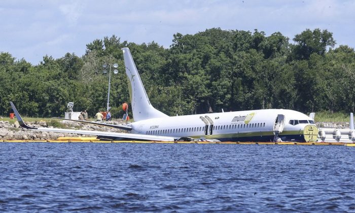 A charter plane carrying 143 people and traveling from Cuba to north Florida sits in a river at the end of a runway in Jacksonville, Fla., on May 4, 2019. (Gary McCullough/AP Photo)