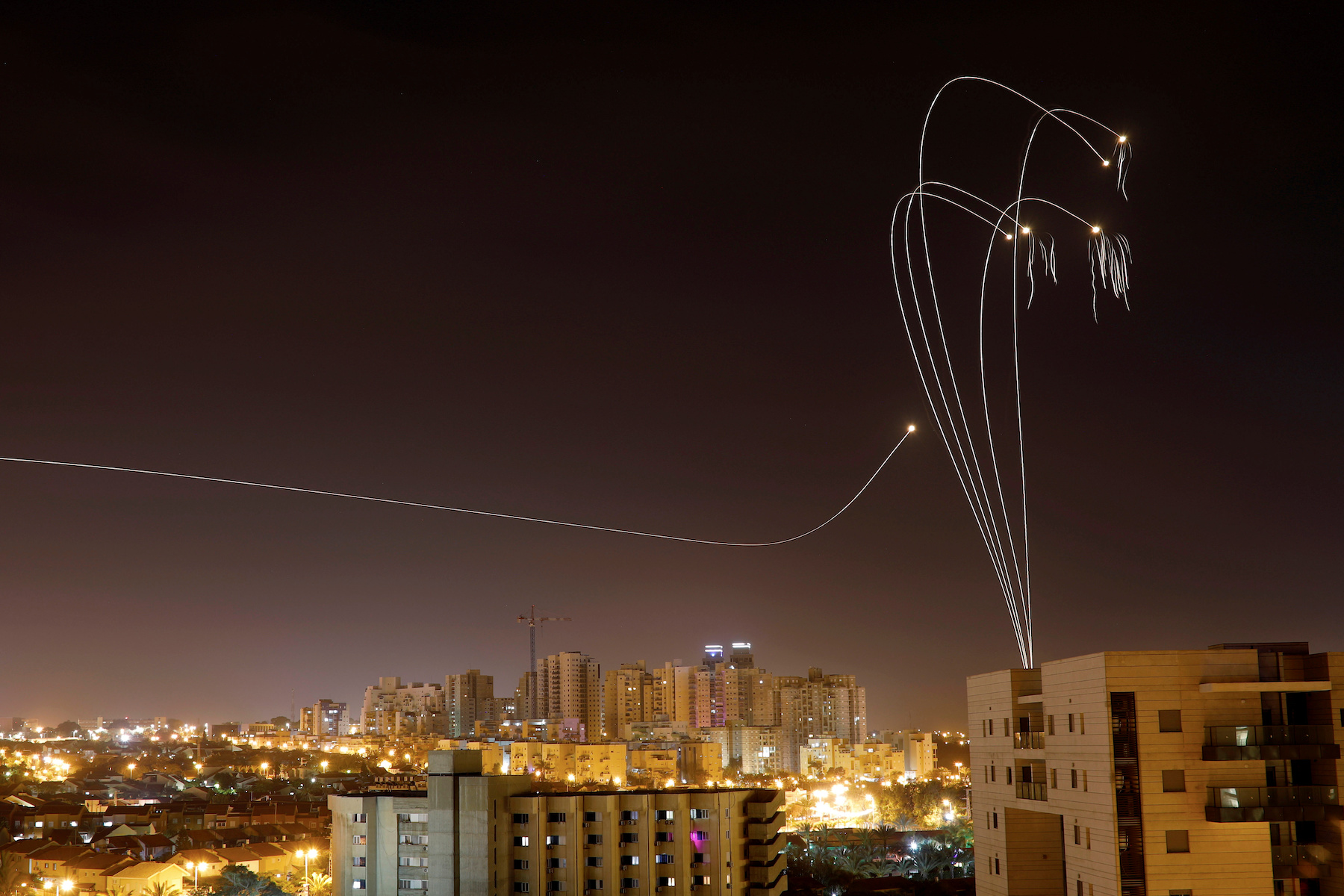 Iron Dome anti-missile system fires interception missiles as rockets are launched from Gaza towards Israel as seen from the city of Ashkelon, Israel