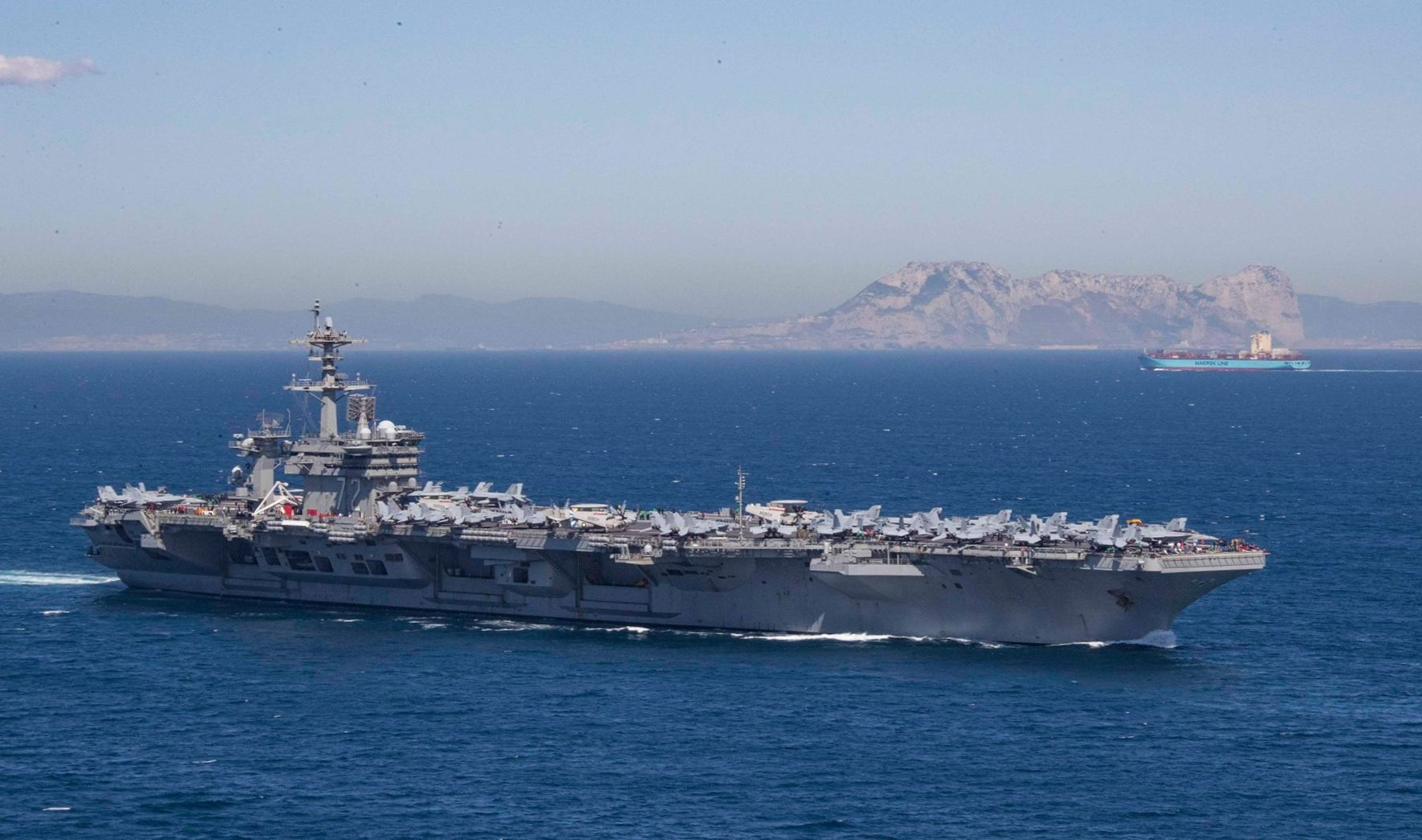 The Nimitz-class aircraft carrier USS Abraham Lincoln transits the Strait of Gibraltar, entering the Mediterranean Sea