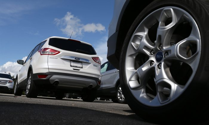 A wheel and a white SUV. (Joe Raedle/Getty Images)