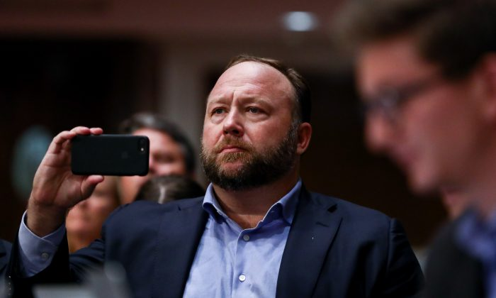 InfoWars founder Alex Jones takes photos at a hearing to examine foreign influence operations' use of social media platforms before the Intelligence Committee at the Capitol in Washington on Sept. 5, 2018. (Samira Bouaou/The Epoch Times)