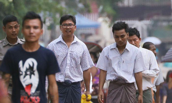 Reuters reporters Wa Lone and Kyaw Soe Oo walk free outside Insein prison after receiving a presidential pardon in Yangon, Burma, on May 7, 2019. (REUTERS/Ann Wang)