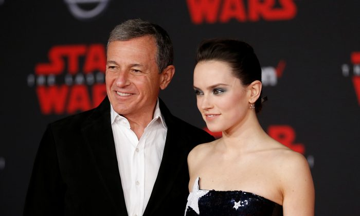 """Chairman and CEO of The Walt Disney Company Bob Iger and actress Daisy Ridley at the world premiere of """"Star Wars: The Last Jedi"""" in Los Angeles, Calif., on Sept. 12, 2017. (Danny Moloshok/Reuters)"""