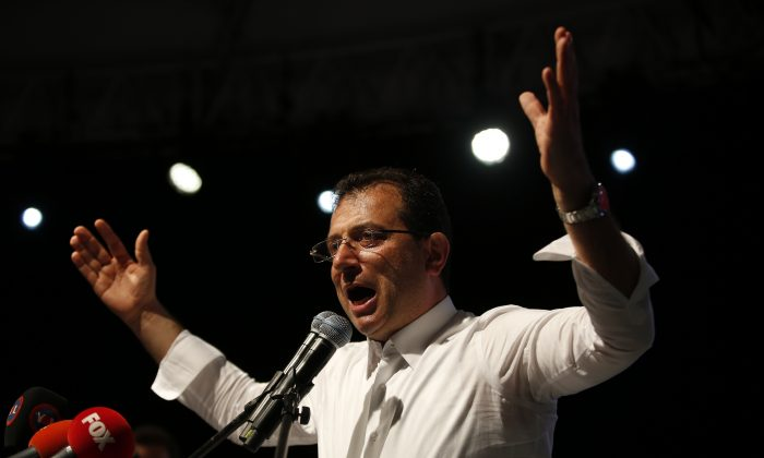 Ekrem Imamoglu, the opposition, Republican People's Party's (CHP) mayoral candidate in Istanbul, gestures during a rally in Istanbul, late Monday, May 6, 2019. (Lefteris Pitarakis/AP Photo)