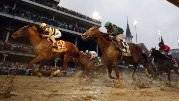Flavien Prat rides Country House (L) to the finish line during the 145th running of the Kentucky Derby horse race