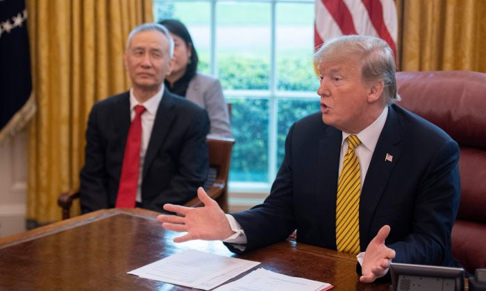 President Donald Trump speaks during a trade meeting with China's Vice Premier Liu He (C) in the Oval Office at the White House in Washington, DC, on April 4, 2019. (JIM WATSON/AFP/Getty Images)