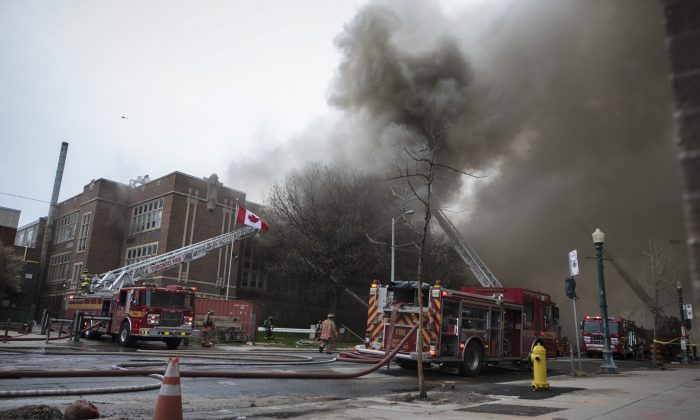 Firefighters work on a fire that broke out at York Memorial Collegiate Institute in Toronto on May 7, 2019. (The Canadian Press/Tijana Martin)