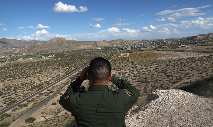 A Border Patrol official looks out into the distant areas around Sunland Park, New Mexico, on Oct. 4, 2016. (John Moore/Getty Images)