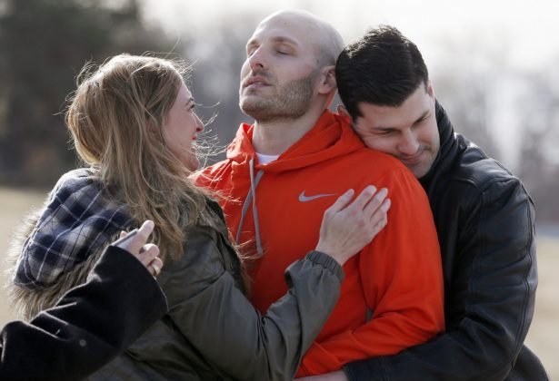 Michael Behenna (C), is embraced by his brother Brett and girlfriend Shannon Wahl following his release from prison in Leavenworth, Kan., on March 14, 2014. (Sarah Phipps/The Oklahoman via AP)