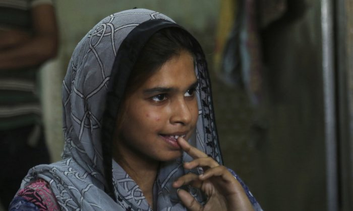 Muqadas Ashraf speaks to The Associated Press in Gujranwala, Pakistan on April 14, 2019. Muqadas Ashraf was just 16 when her parents married her off to a Chinese man who had come to Pakistan looking for a bride. Less than five months later, Muqadas is back home in Pakistan, pregnant and seeking a divorce from a husband she says was abusive. (K.M. Chaudary/AP Photo)